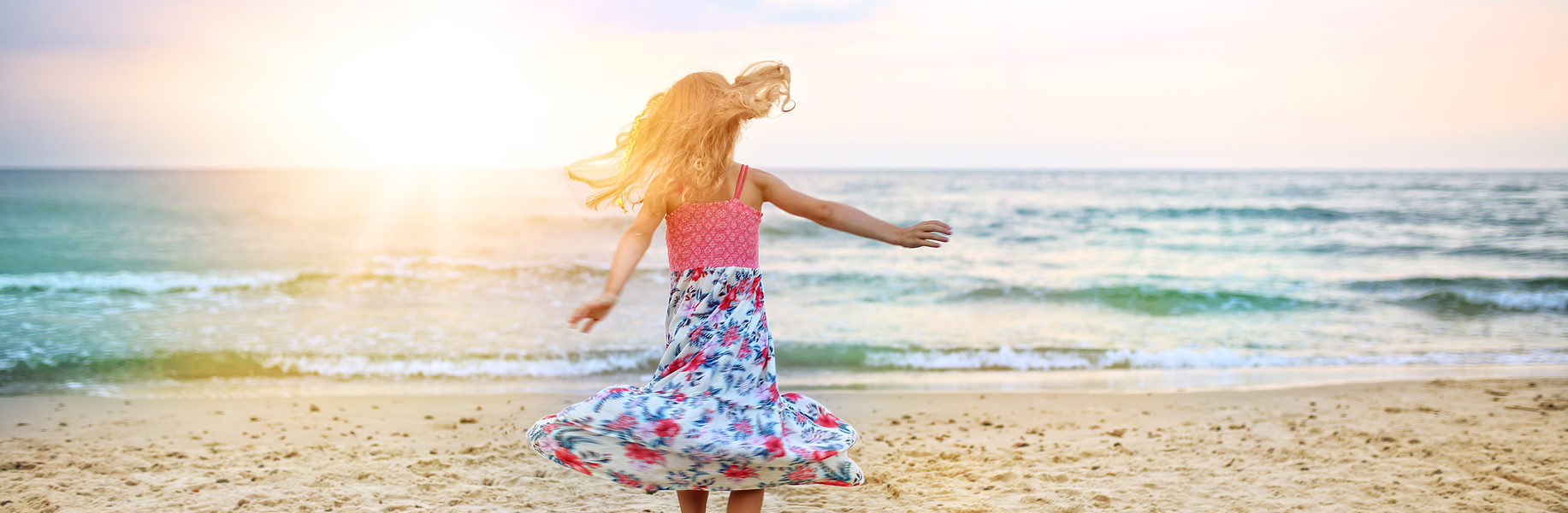 carefree girl dancing on the beach in a dress joy