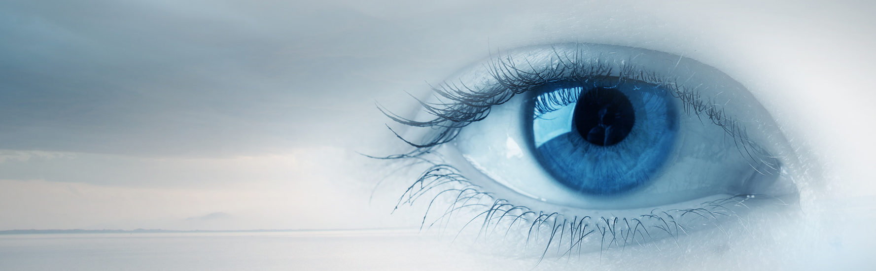 Female blue eye on cloudy sky background consciousness